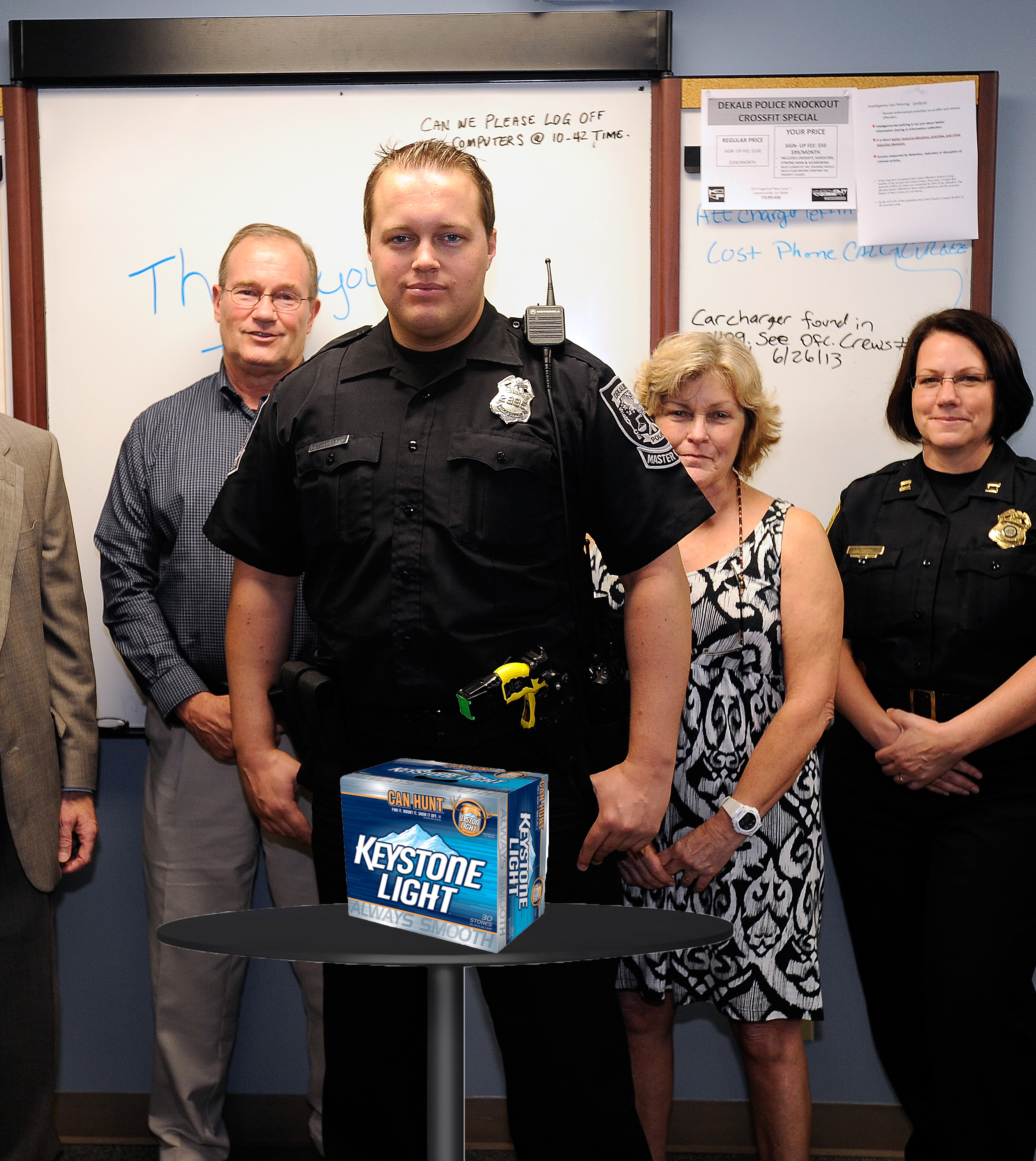 Cpt. Jennings and his squadron pose behind the confiscated narcotics from the milestone bust.